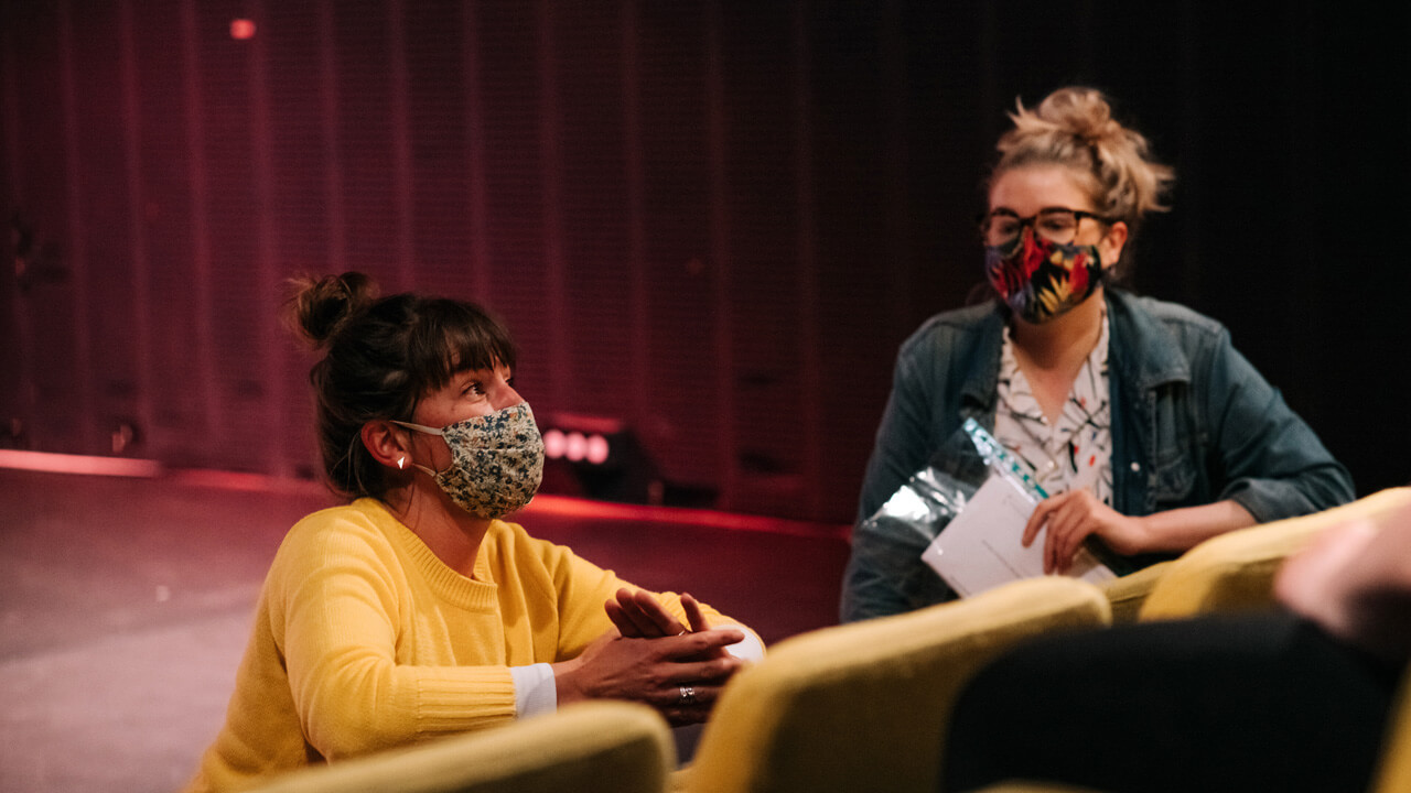 Inside the auditorium at the screening of the film Masquerade at North Edinburgh Arts - Gemma and Lisa are introducing the film.