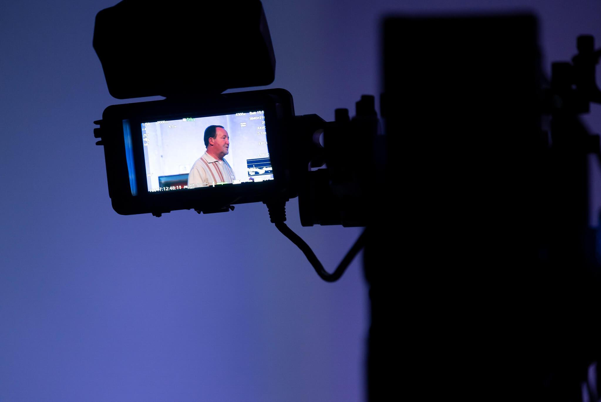 Rehearsal image for Fibres films showing a camera monitor displaying Jonathan Watson