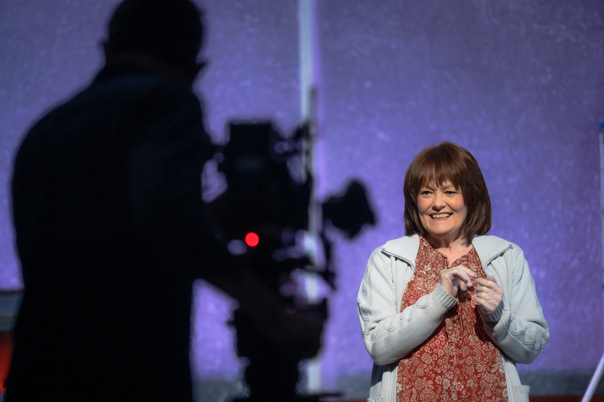 Rehearsal image for Fibres films showing Maureen Carr being filmed