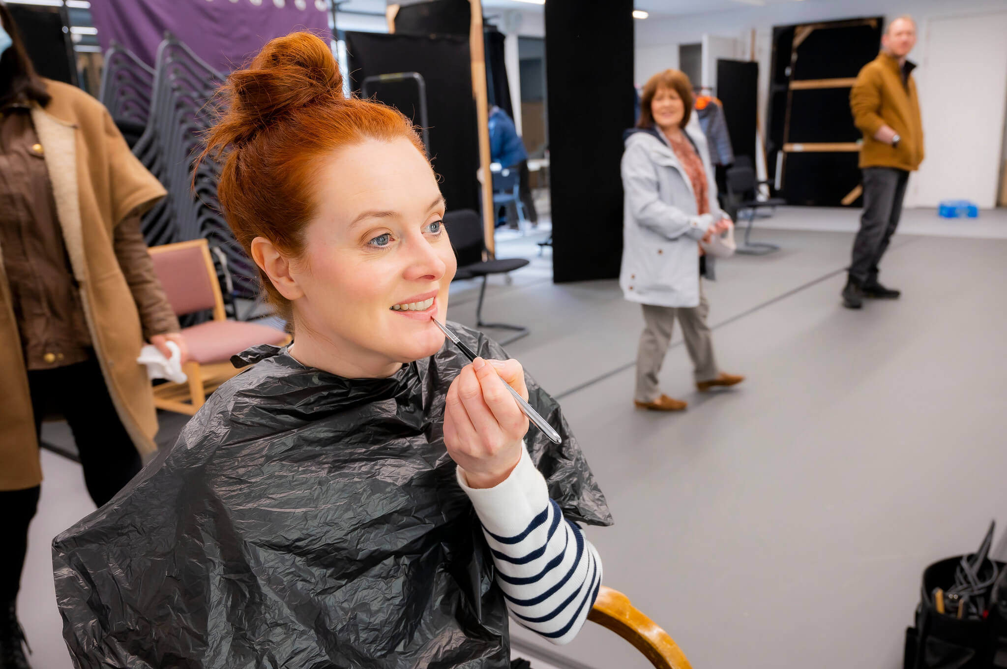Rehearsal image for Fibres films showing Suzanne Magowan doing makeup