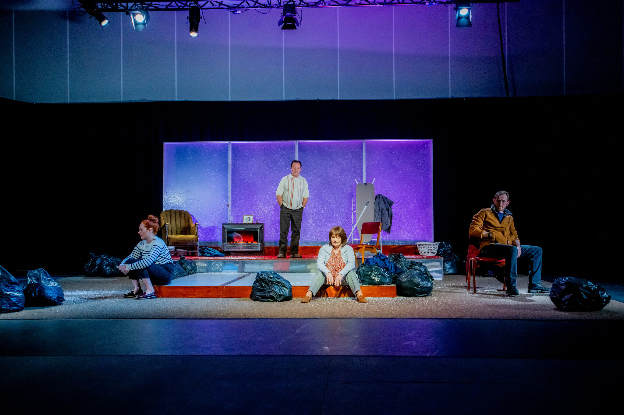 Production shot of the full set with the cast spaced out within it