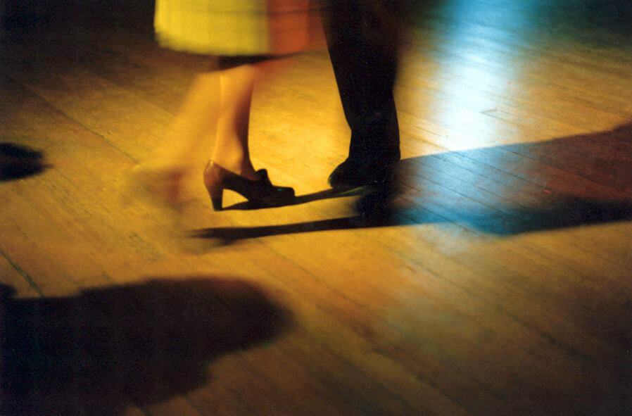 Learning the Paso Doble promotional image showing a slose up of two pairs of feet dancing, one is wearing brown heels and one if wearing flat black mens shoes