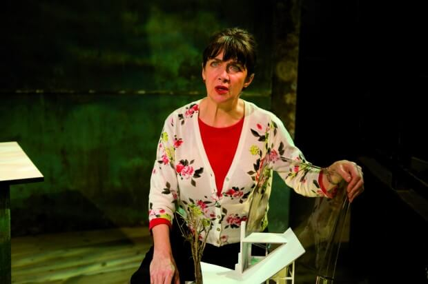 Production image for The List showing Maureen Beattie wearing a flowery cardigan and red top
