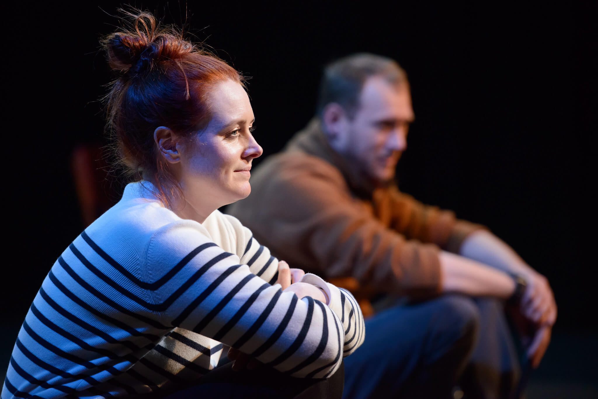 Fibres Film production image showing Suzanne Magowan sitting with her arms folded and Ali Craig sitting in the background