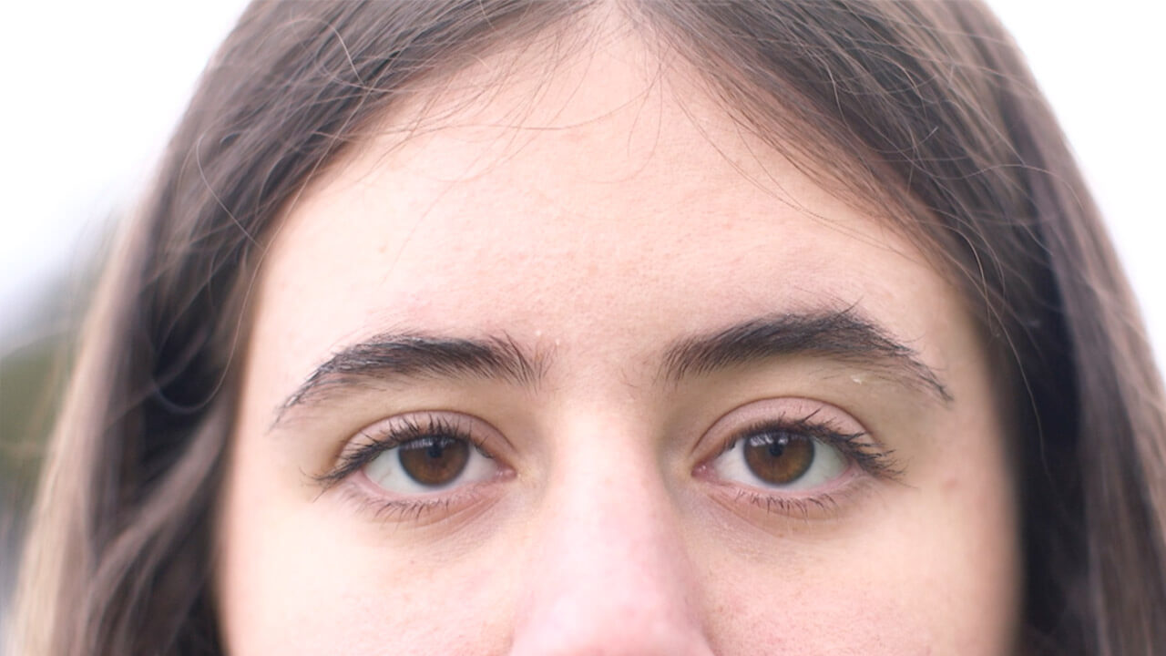Close up of a woman's eyes and forehead.